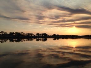"""Heaven meets earth"" Sunset over the Okavango on the Namibia/Angola border..."