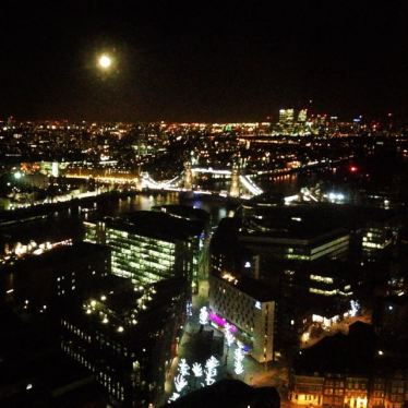 View over London Bridge at full moon from our 23rd anniversary dinner table!